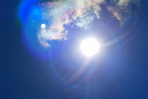 Sky with sun & moon